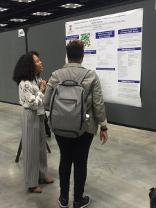 Student Michelle presenting poster at conference